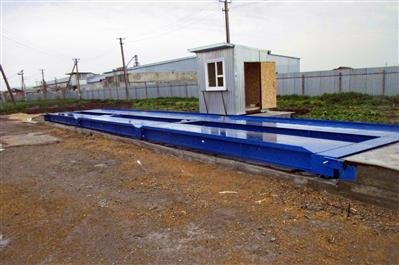 Автомобильные весы ВАЛ с бетонными въездными пандусами и оборудованной будкой весовщика. фото #9
